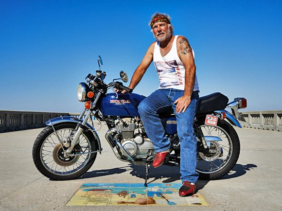 Jacques Reymond on his much loved vintage Honda motorbike