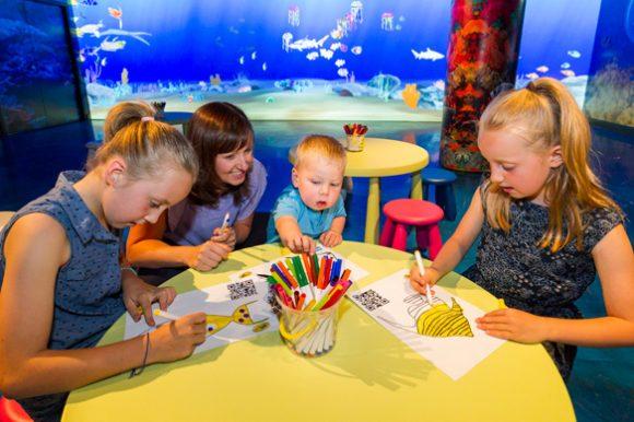 Children creating art at the Art Aquarium