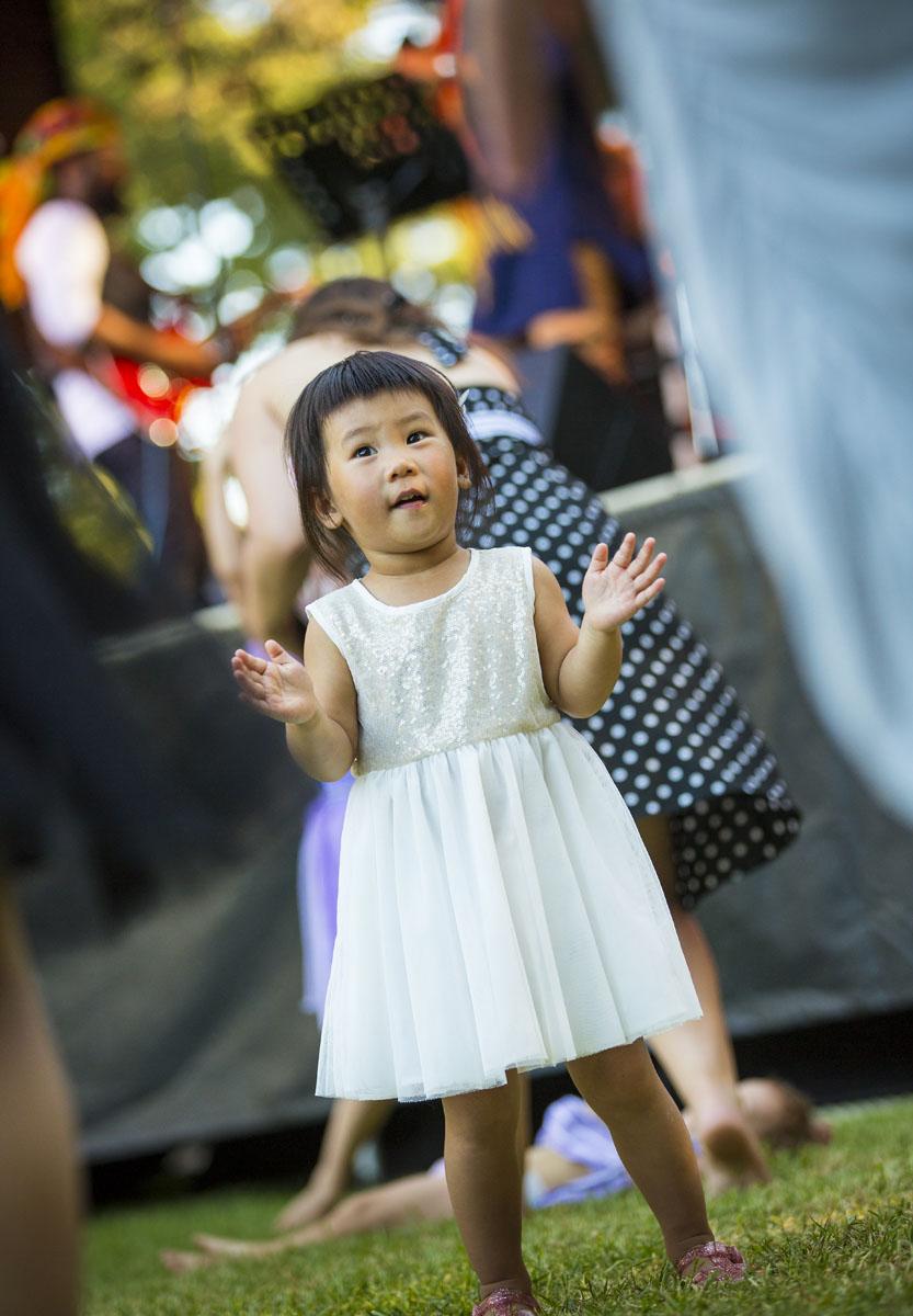 A little girl in a white dress.