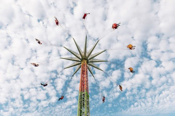 People high up in the air in a carnival ride