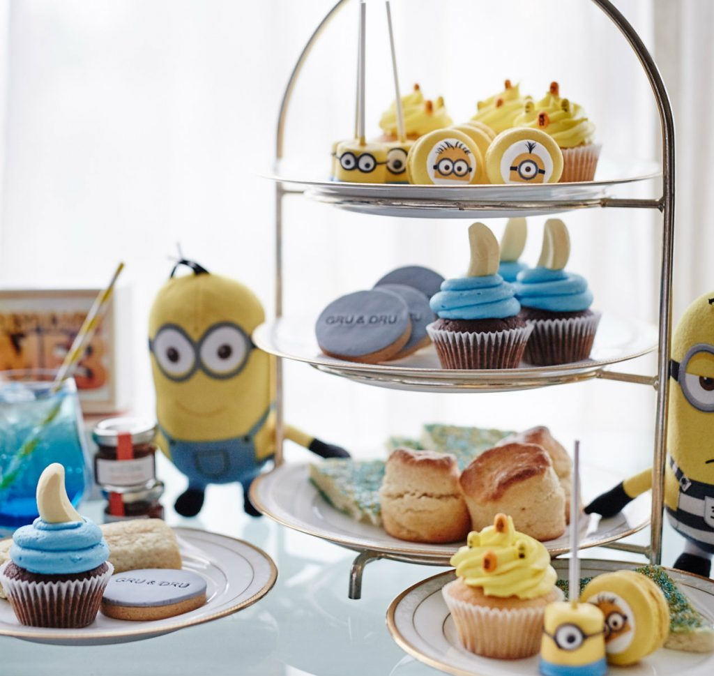 A tiered stack of colourful cakes made to look like cartoon characters