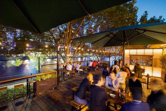 Arbory Bar at night along the Yarra River