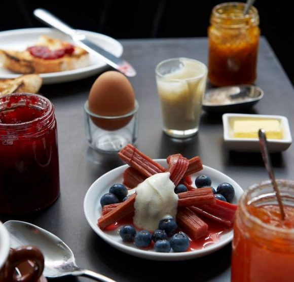A spread of boiled eggs, fruit, yogurt, juice and preserves