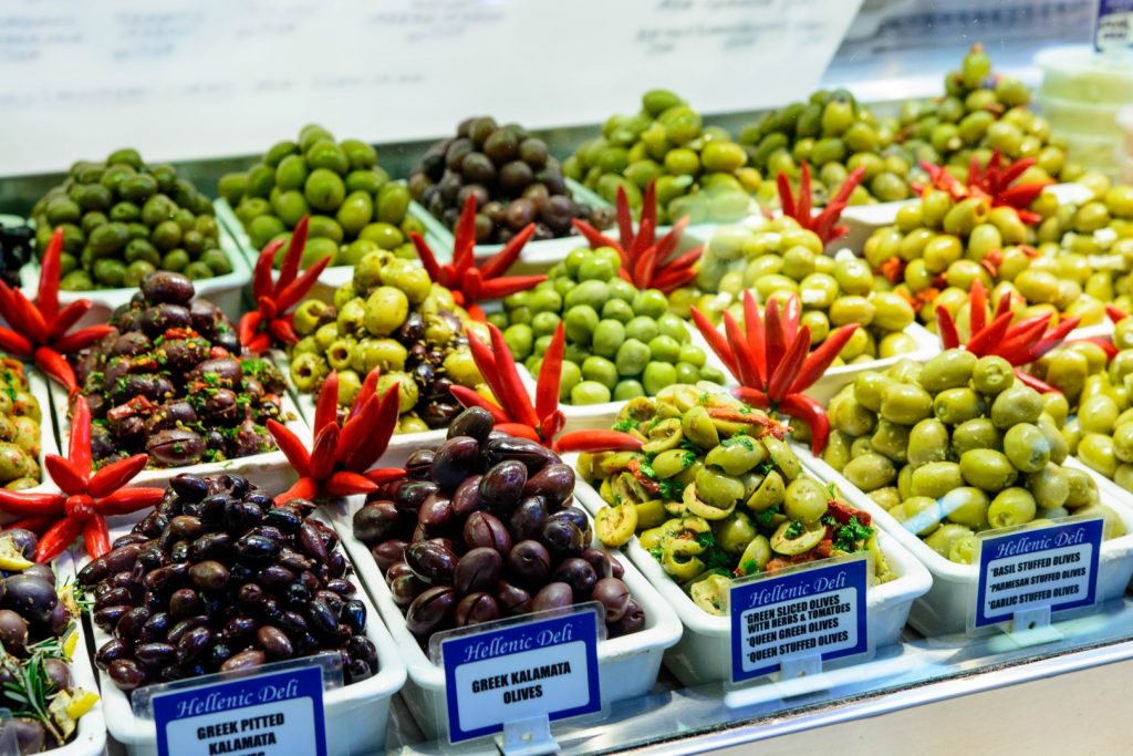 Deli display with more than 15 different types of olives