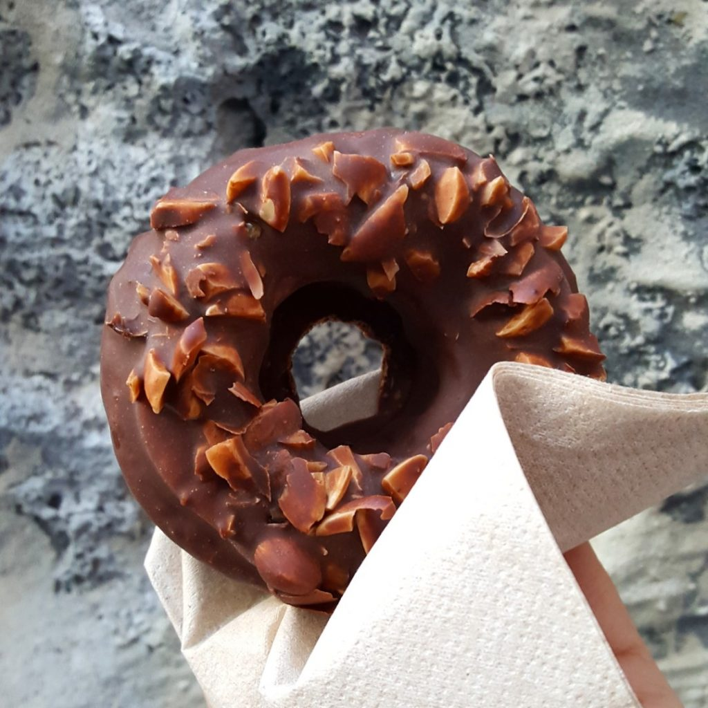A hand holding a doughnut