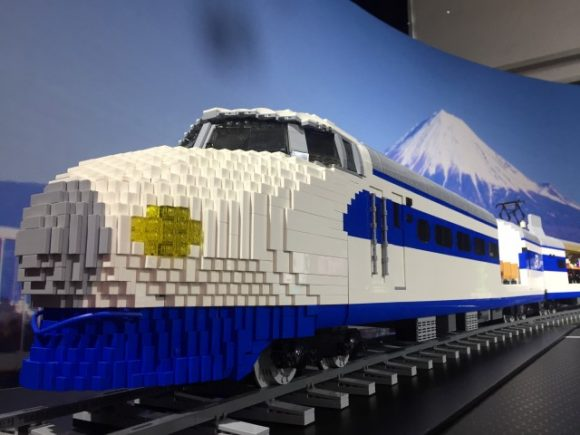 A modern looking train made entirely from lego