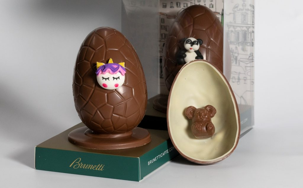 Chocolate eggs cut in half with different cute animal decorations on them