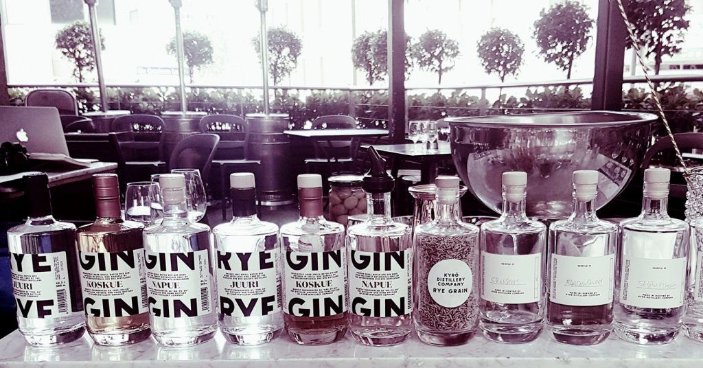 Ten gin bottles on a table in a restaurant
