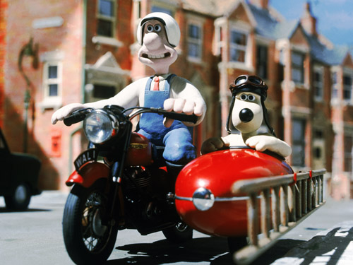 Claymation characters Wallace and Gromit on a motorcycle with sidecar