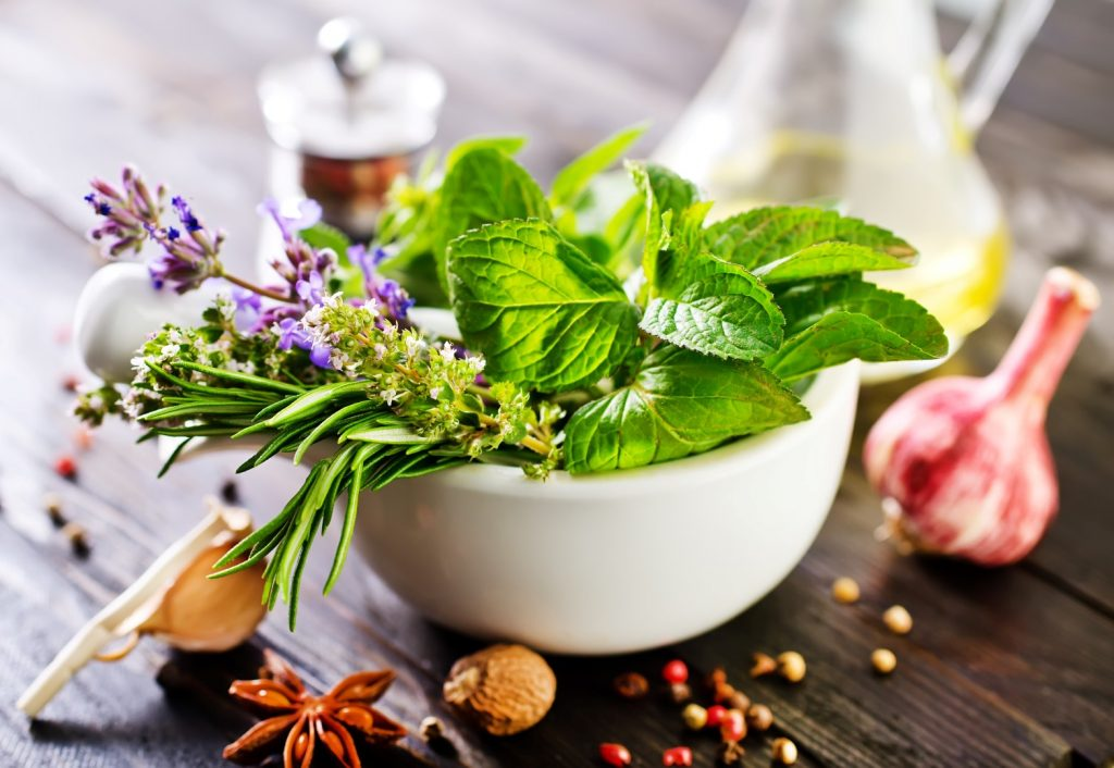 A bowl of herbs on a table