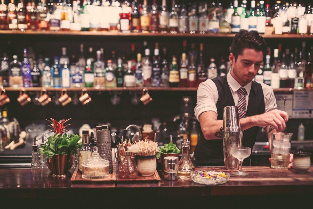 A bartender making cocktails