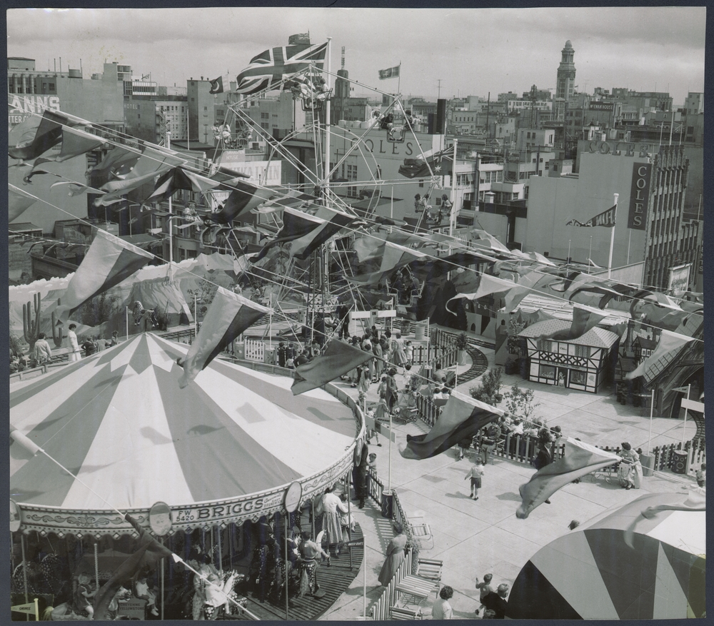 An old photo of a fun park with different carnival rides