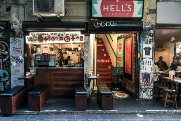 A tiny cafe in a street art covered laneway