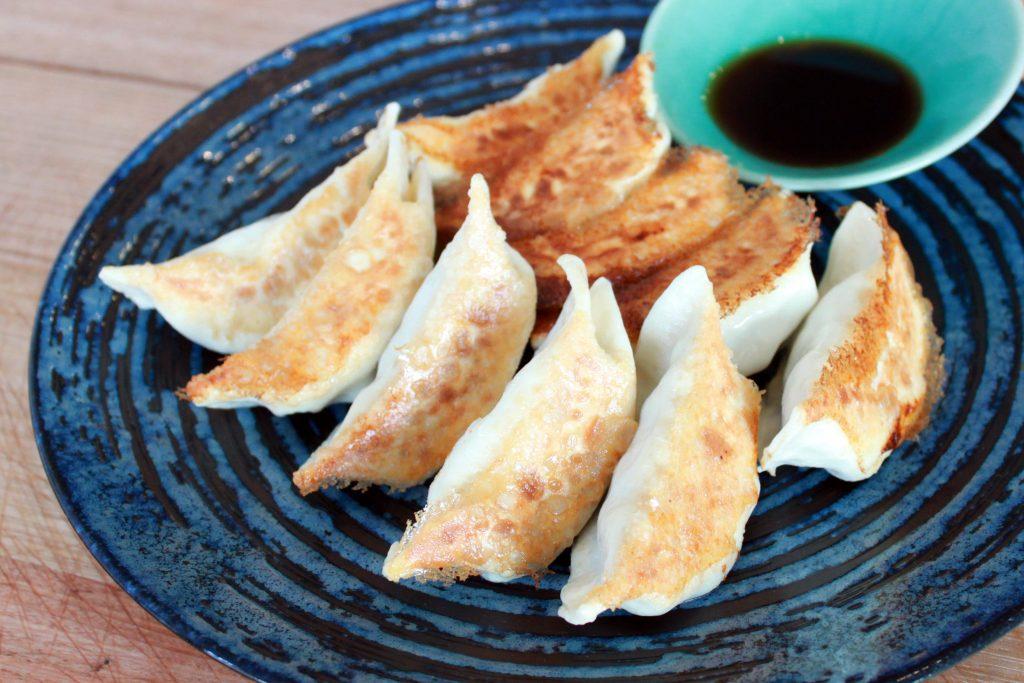 ten fried dumplings on a plate