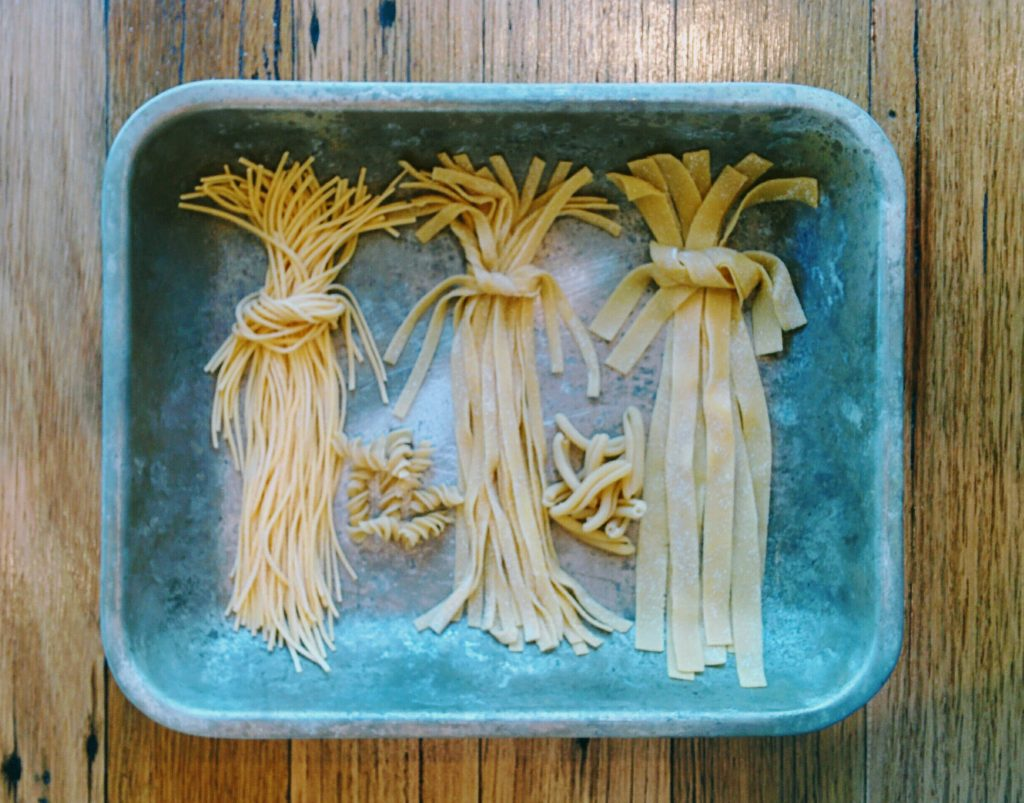 Raw fettucini paste on a tray