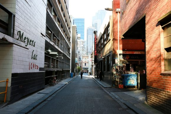 A laneway with restaurants on either side