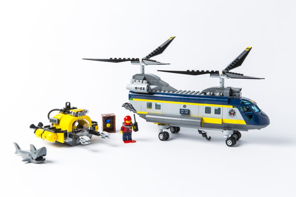 A submarine, humanoid and double propellered helicopter made from Lego