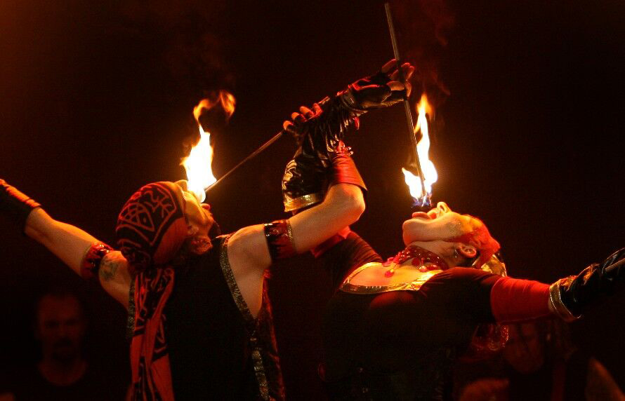 Two performers eating fire