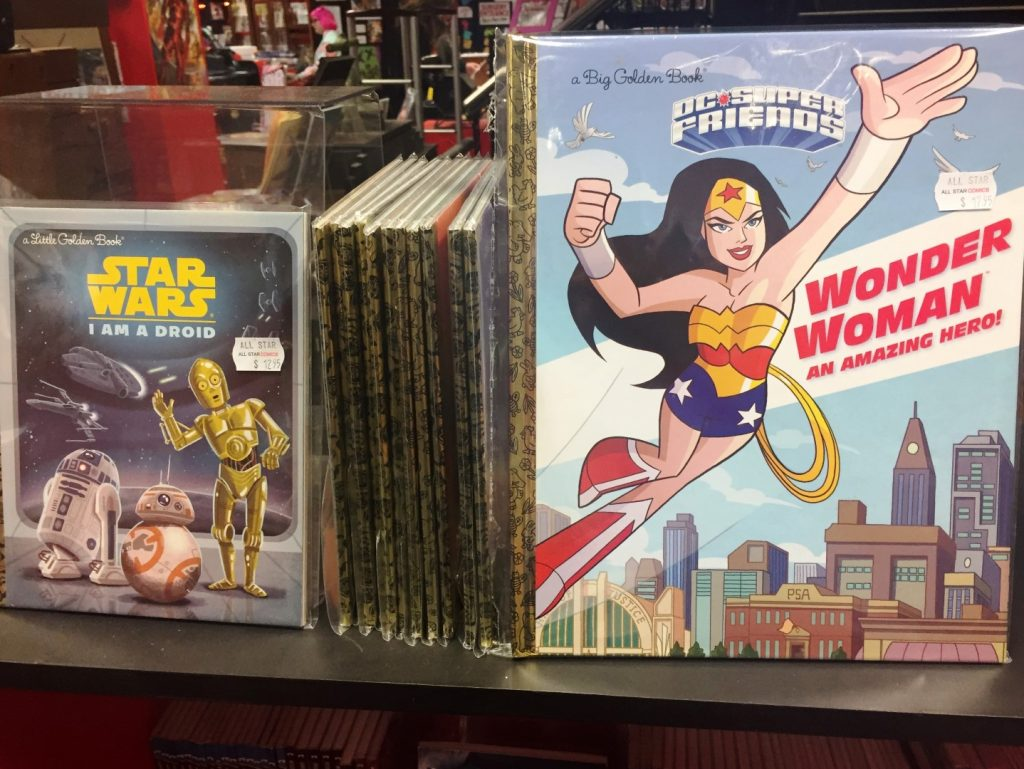 Kids books on a shelf including Star Wars and Wonder Woman