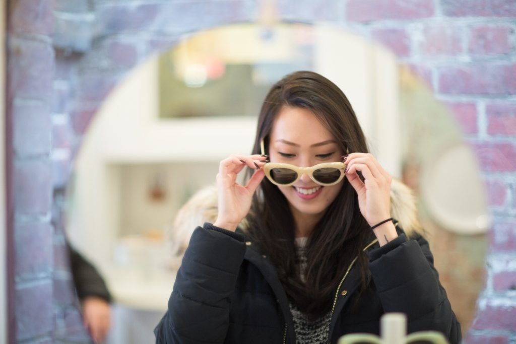 A girl trying out a sunglass