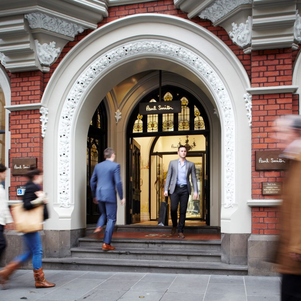 People walking through an attractive arched doorway