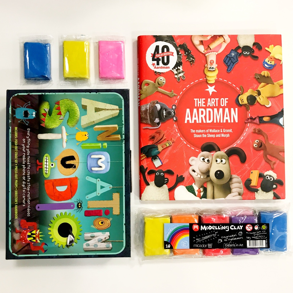 Coloured modelling clay, an animation studio play kit and the Art of Aardman book
