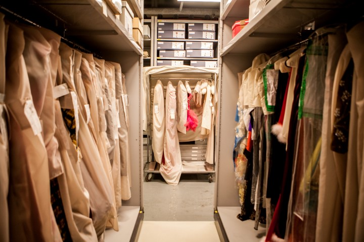 Inside a large wardrobe with multiple racks of clothing