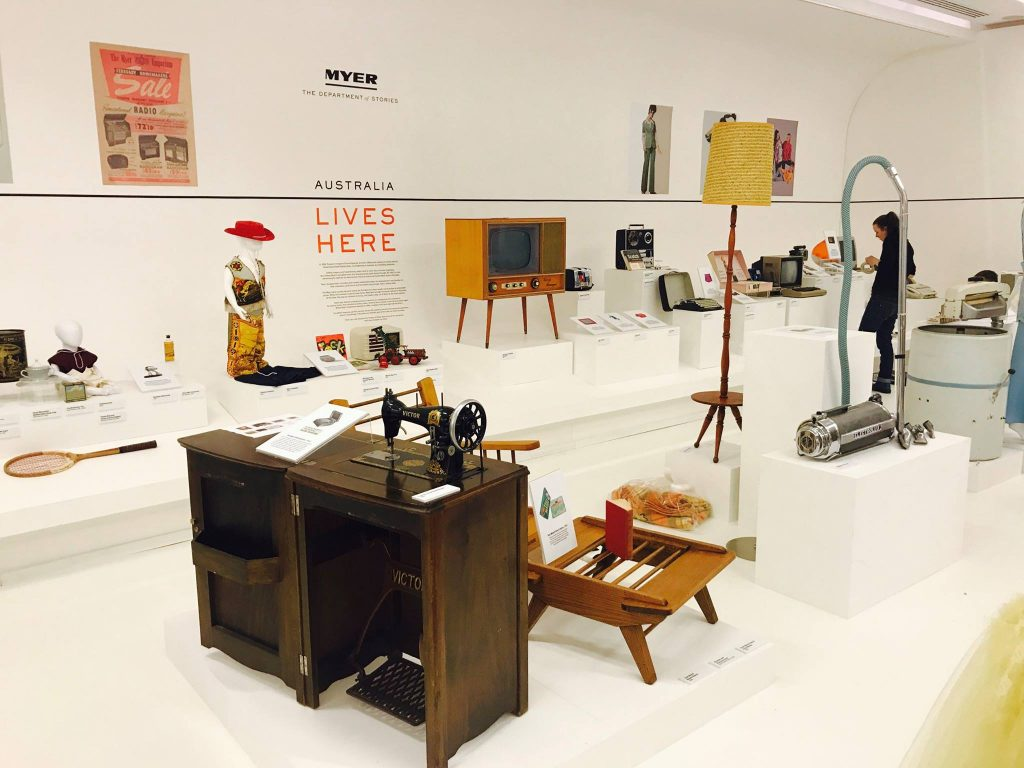 An exhibition featuring old household items including a sewing machine, a vacuum cleaning and an old television