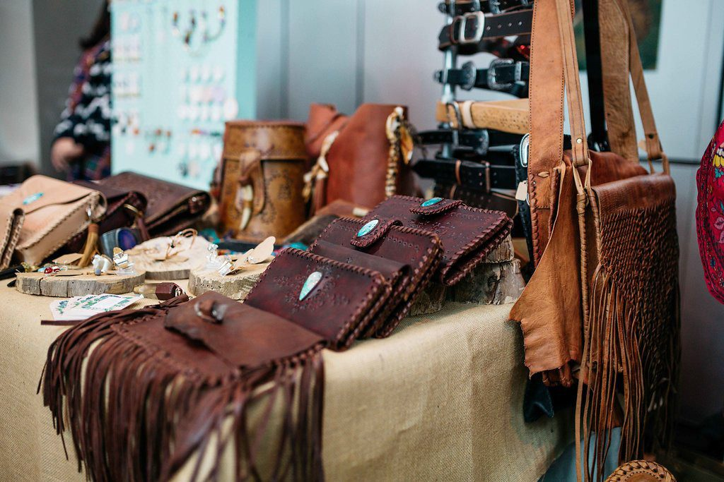 A table covered with leather bags.