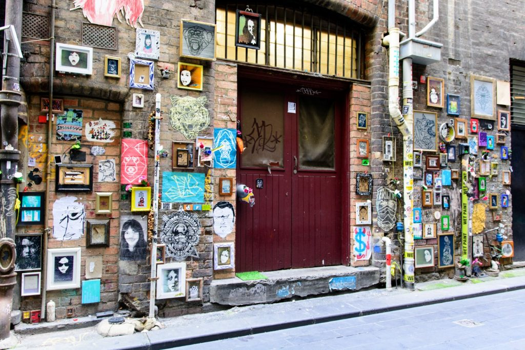 A street art covered laneway and door entrance.
