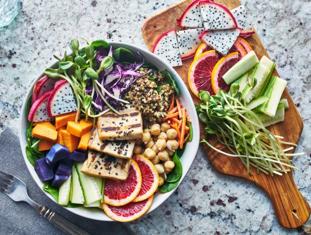 grilled tofu and dragon fruit buddha bowl top view