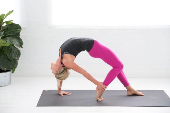 A woman in a backward arch yoga pose