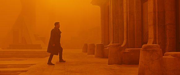 A man walking into a dusty ruin