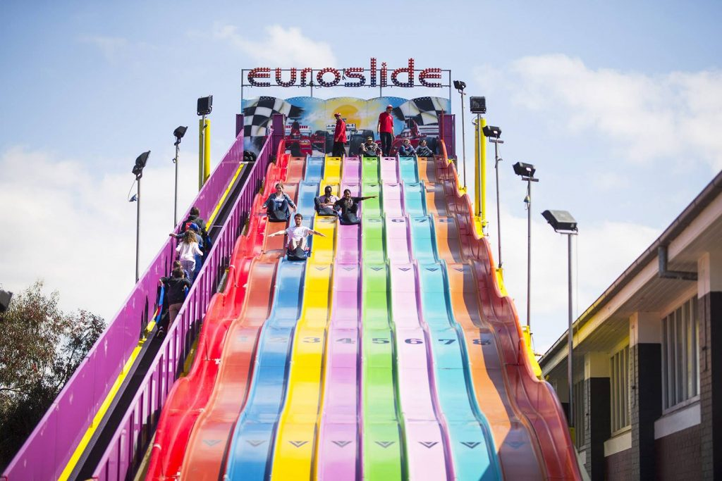 People sliding down a giant slide