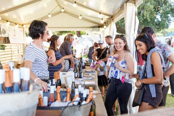 Group of people enjoying a wine tasting at Taste Melbourne