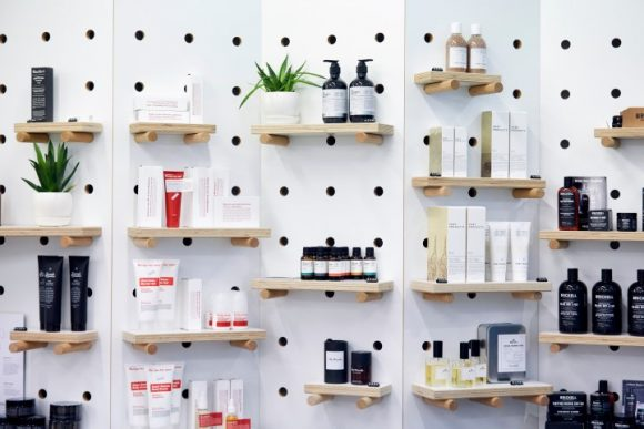 Store display shelves featuring candles and beauty products