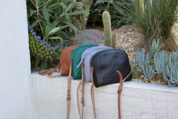 A group of bags sitting next to a garden