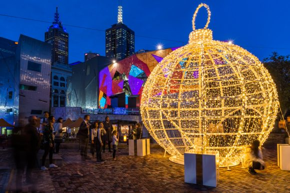 A large Christmas bauble rigged with lighting so it glows