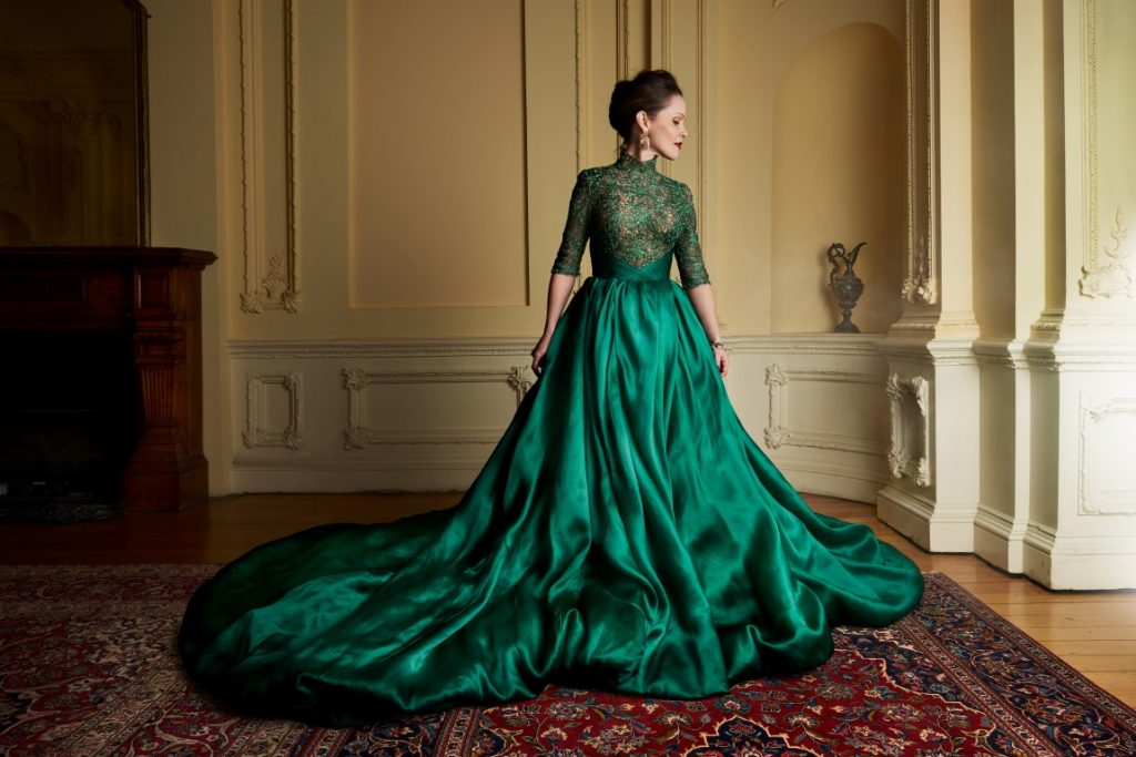 A woman wearing a ballroom gown