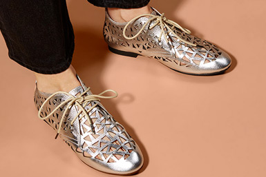 Silver metallic lazer cut leather brogues with tan laces.