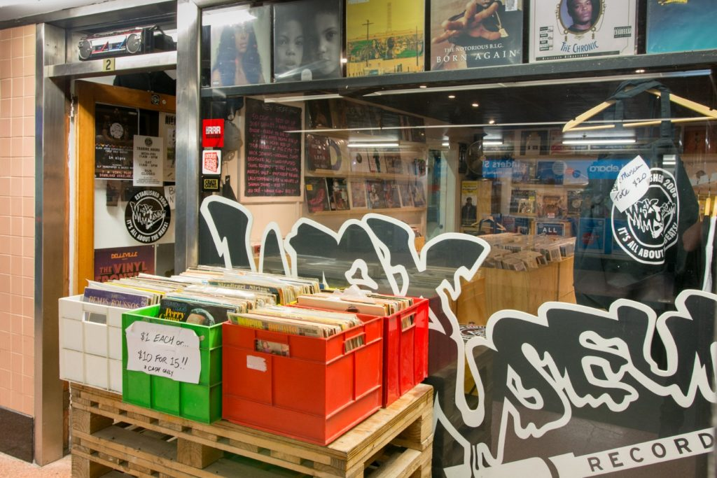 Several crates of records outside a music shop
