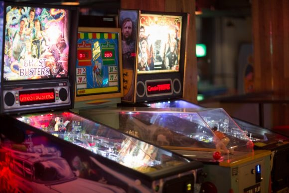 Two pinball machines in a bar