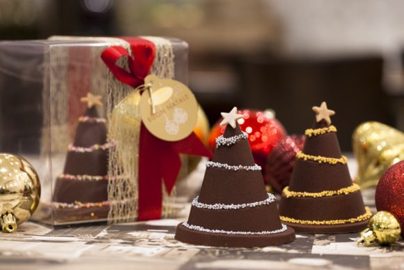 Several desserts made of chocolate and shaped like Christmas trees