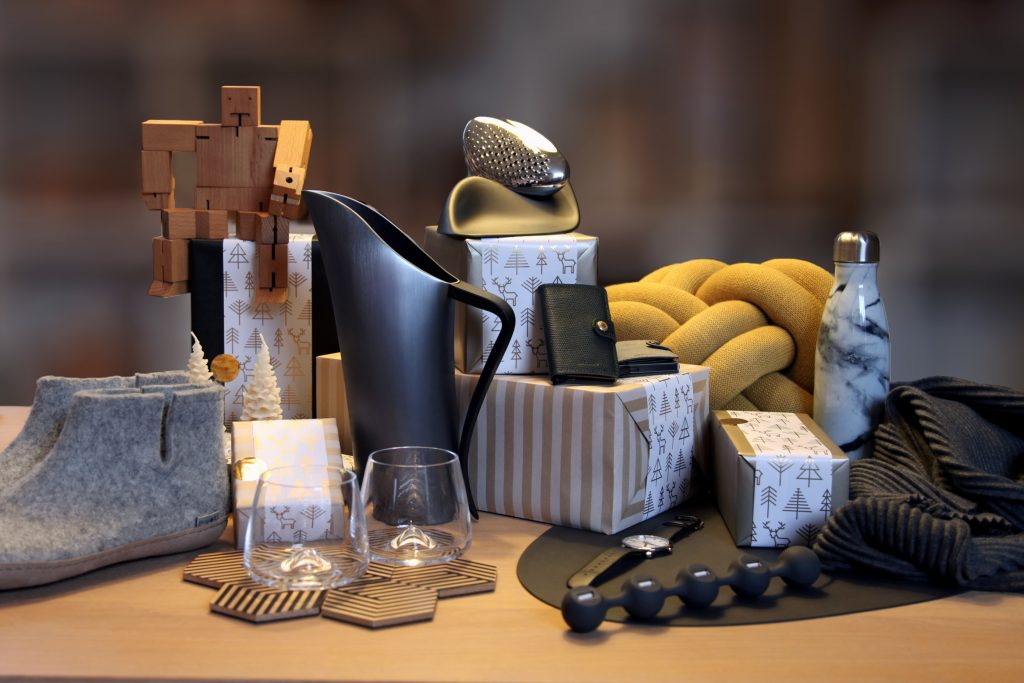 A collection of homewares, shoes and accessories on a table