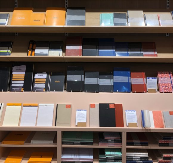 Shelves displaying diaries, journals and note pads