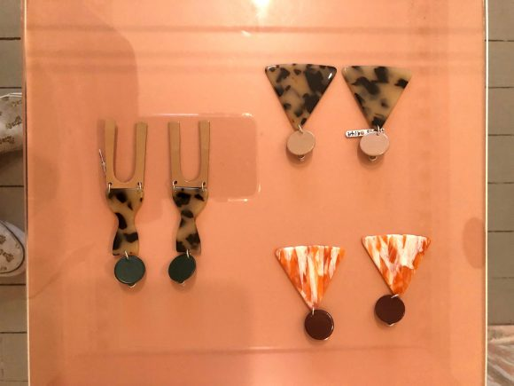 Three sets of a earrings on display in a shop
