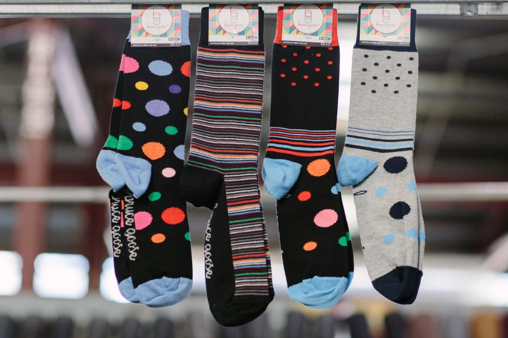 Four pairs of socks hanging from a line