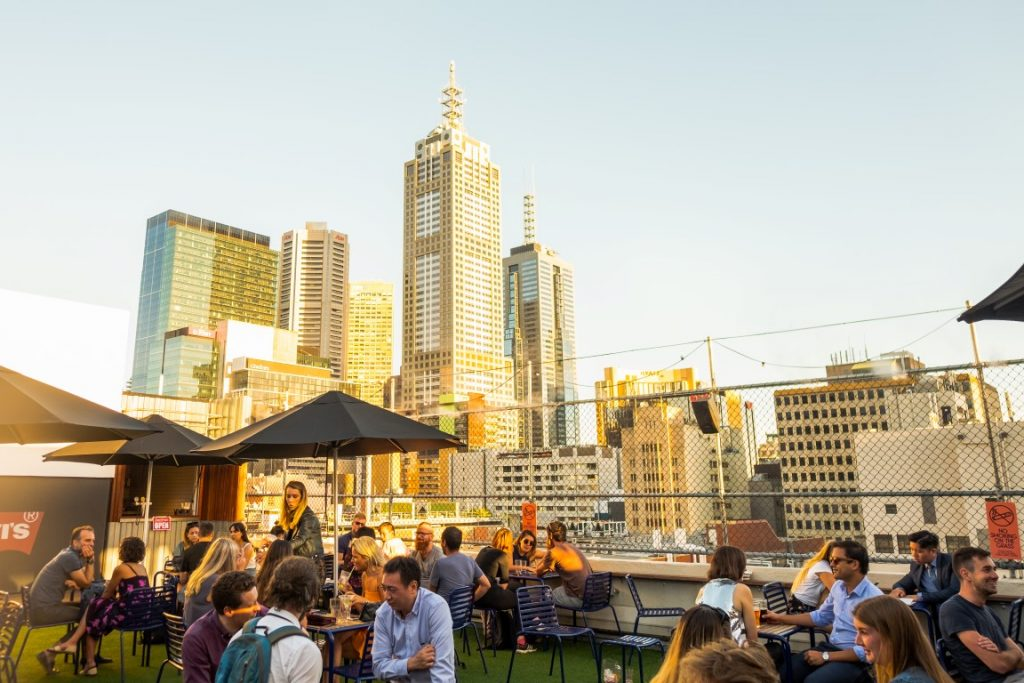 Rooftop bar with people and city skyline