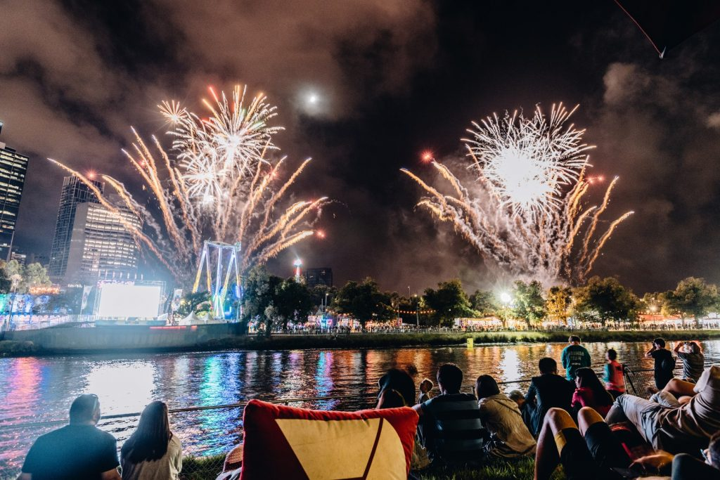 Fireworks over the river at night