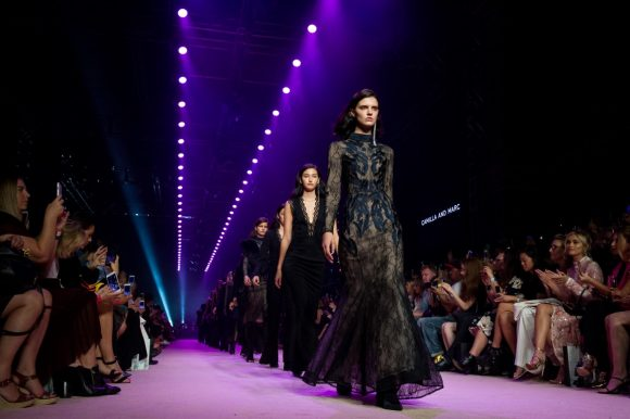 Models walking on a runway at a fashion show
